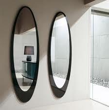 Specchi in soggiorno: dove posizionarli per una migliore resa
